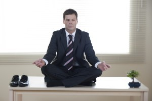 young business man in mindfulness meditation
